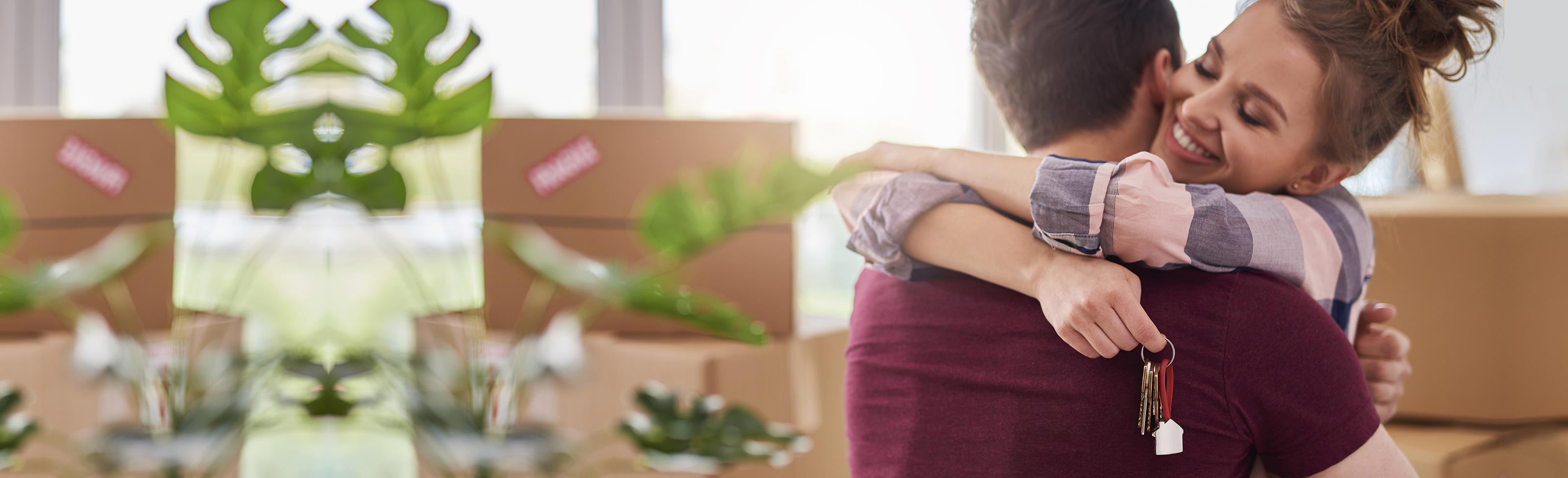 Couple hugging while unpacking