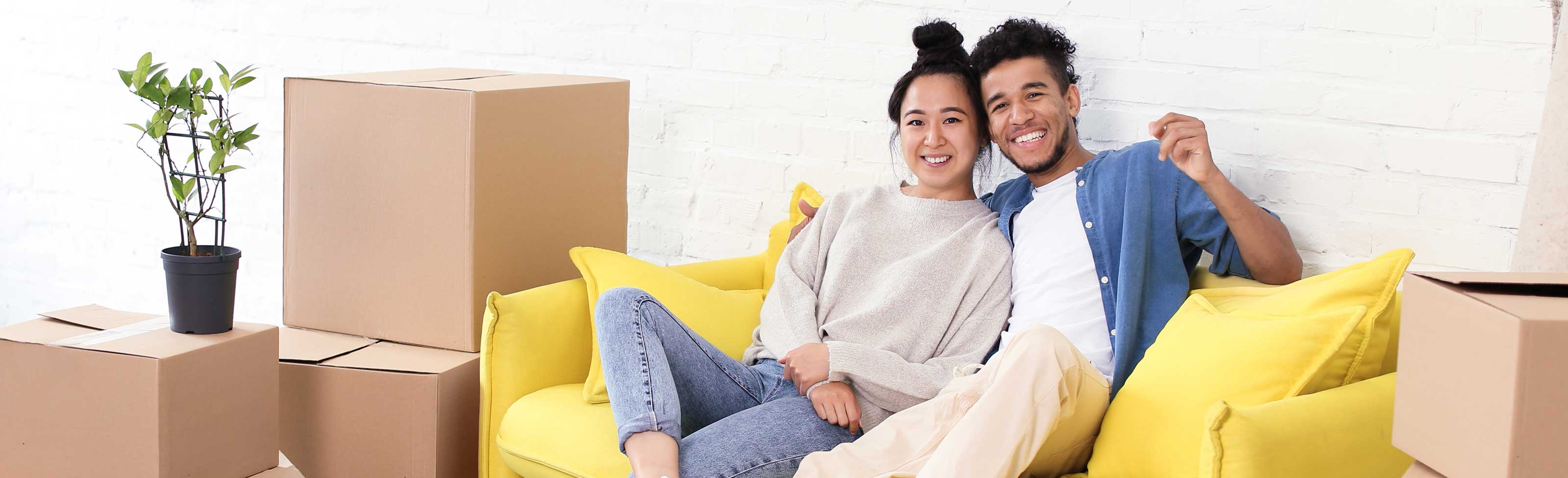Young couple unpacking in new home