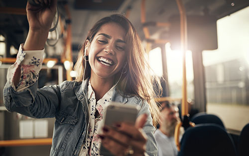 Smiling young woman riding a bus